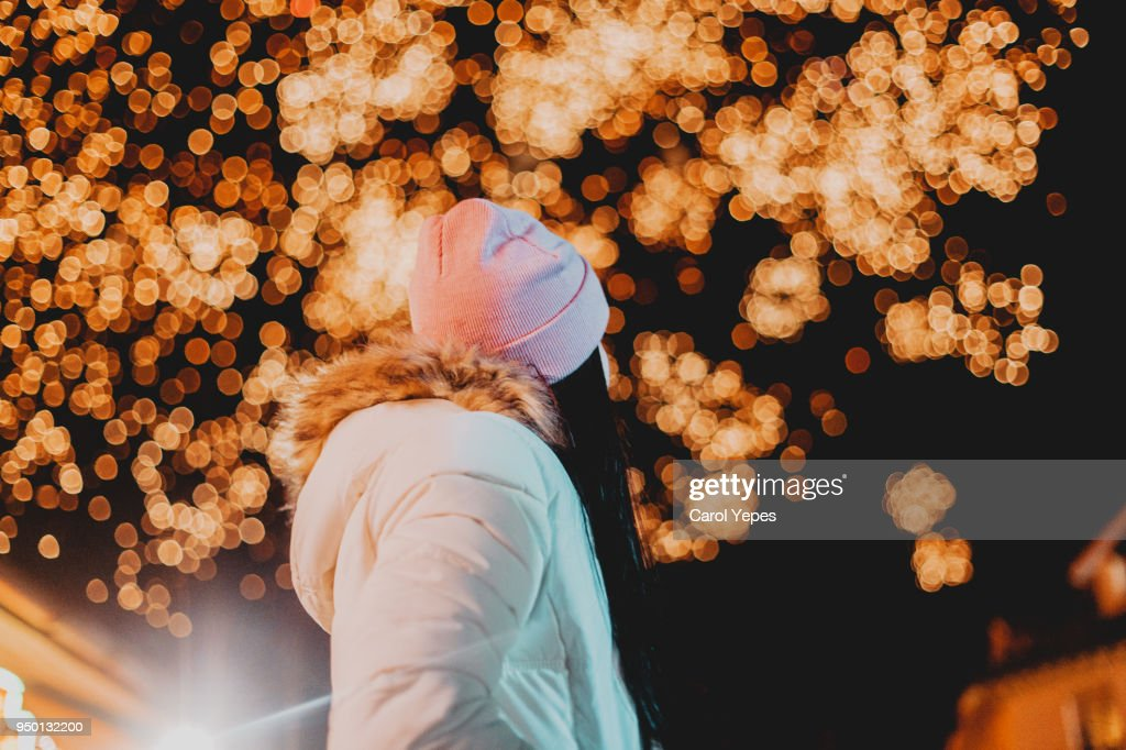 young woman looking the fireworks in the sky : Stock Photo