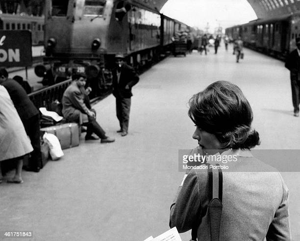 A young woman looking thoughtful on the platform at Milan Central Station Milan April 1961