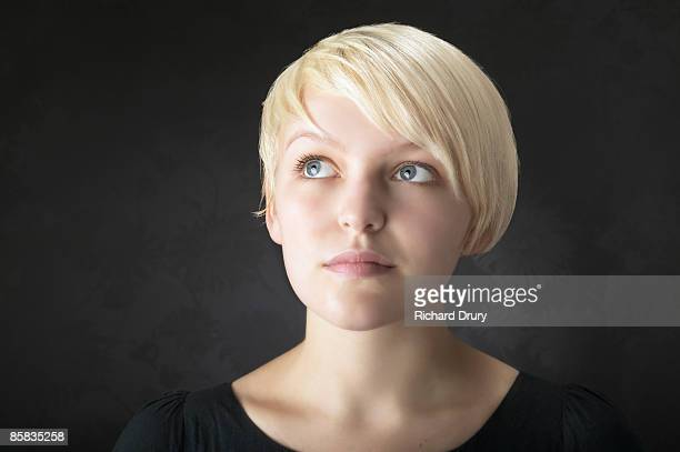 young woman looking thoughtful - richard drury stock pictures, royalty-free photos & images