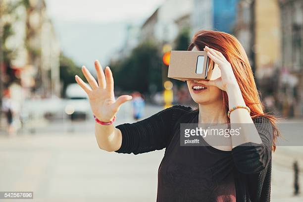 Young woman looking through a reality simulatop