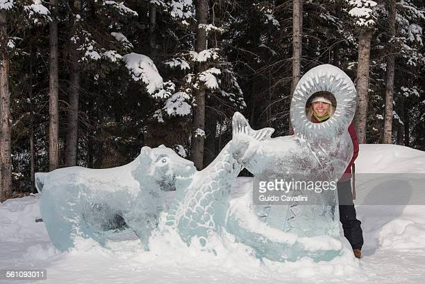 Young woman looking through ice sculpture