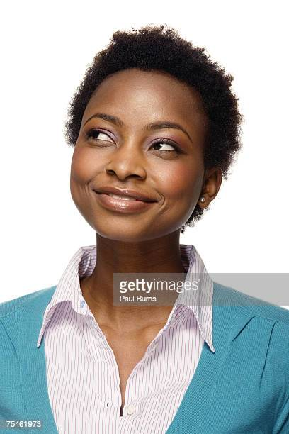 young woman looking to side, smiling, close-up - sideways glance stock pictures, royalty-free photos & images