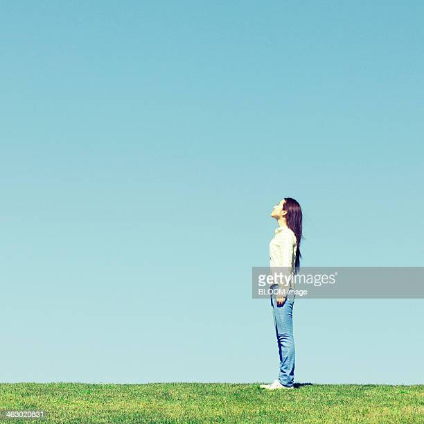 Young Woman Looking Towards Sky