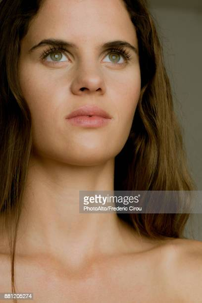 young woman looking up in thought, portrait - clavicle stock photos and pictures