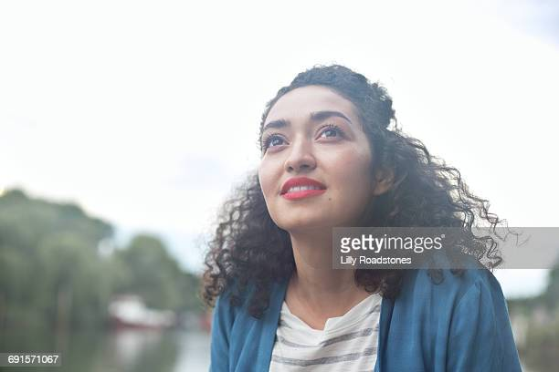 young woman looking up into the sky - hope stock pictures, royalty-free photos & images