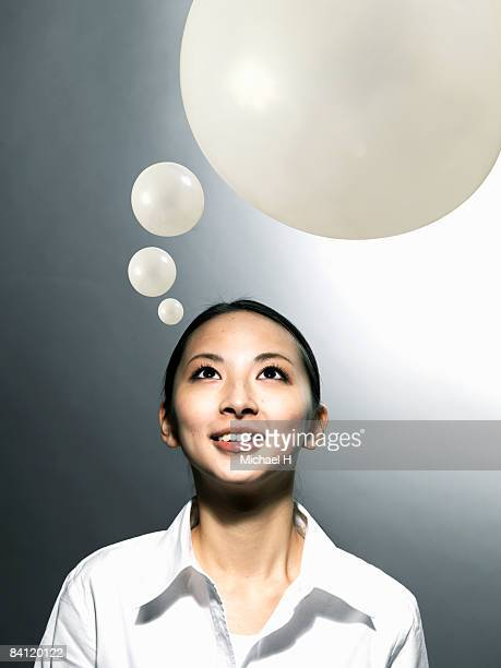 young woman looking up,portrait,close-up - thought bubble stock pictures, royalty-free photos & images
