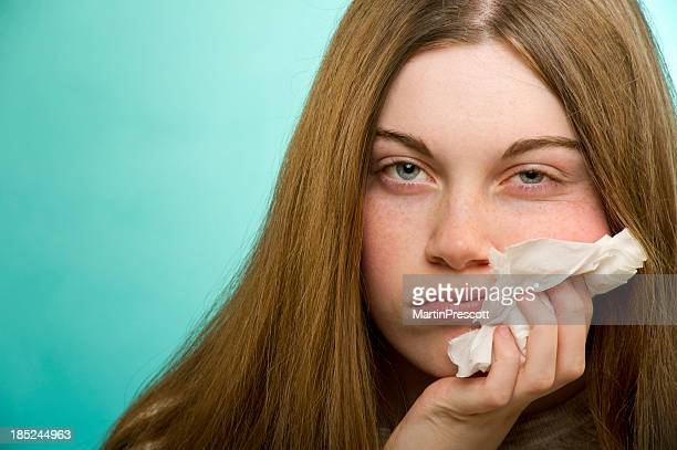 Young woman looks miserable while suffering from allergies