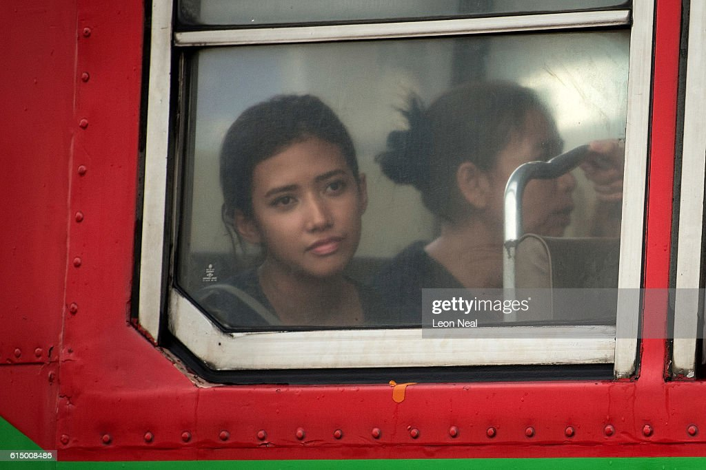 A young woman looks out of a bus window towards the Grand Palace as mourners travel from across the country to pay their respects to Thailand's late King, on October 16, 2016 in Bangkok, Thailand. Thailand's King Bhumibol Adulyadej, the world's longest-reigning monarch, died at the age of 88 in Bangkok's Siriraj Hospital on Thursday after his 70-year reign. The Crown Prince Maha Vajiralongkorn had asked for time to grieve the loss of his father before becoming the next king as the nation waits for the coronation date.