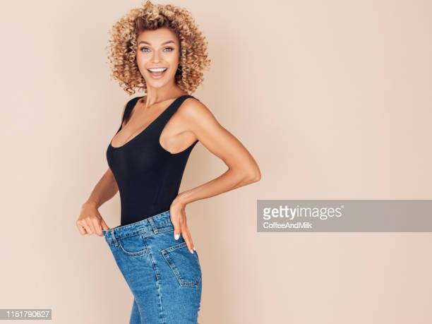 young woman losing weight - dieting stock pictures, royalty-free photos & images