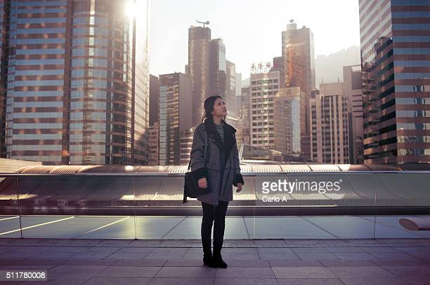 Young woman lost in the city