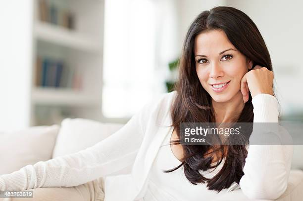 Young Woman Lounging in Living Room on Couch