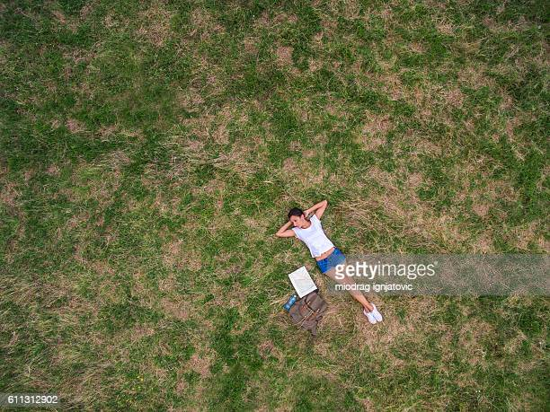 Young woman lying down on the ground,aerial view
