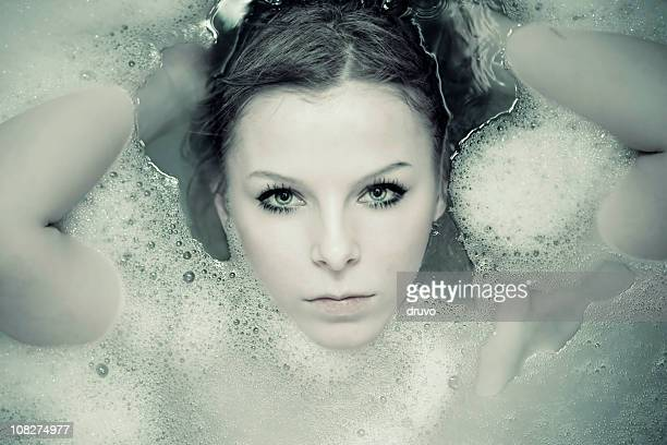 Young Woman Lying in Bathtub, Toned