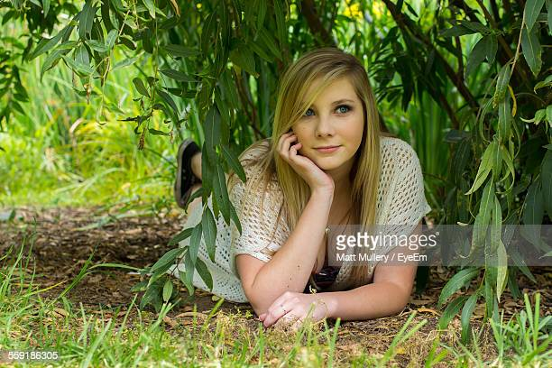 young woman lying in park day dreaming - fullerton california stock photos and pictures