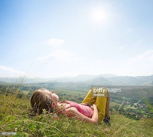 Young woman lying in the grass
