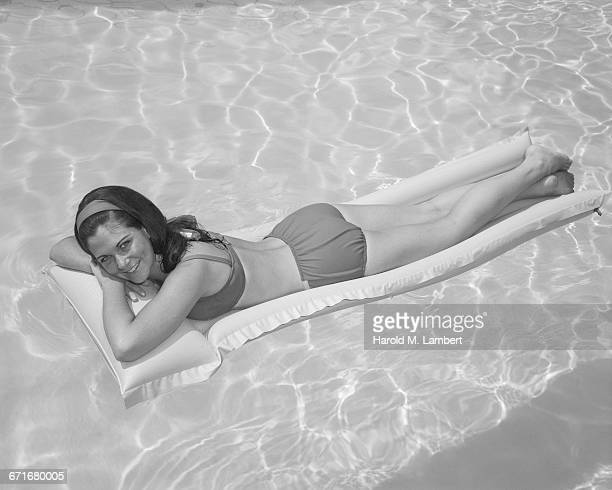 ' Young Woman Lying On Air Bed In Swimming Pool, Portrait'
