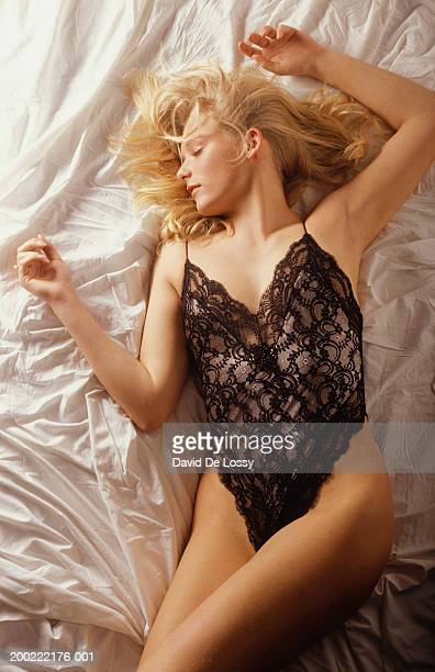 Young woman lying on bed in underwear