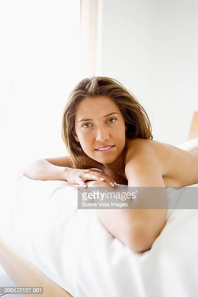 Young woman lying on bed, portrait