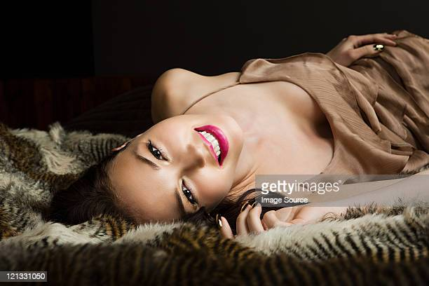 young woman lying on blanket, portrait - women in slips stock photos and pictures