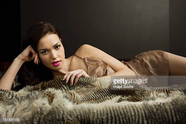 young woman lying on blanket, portrait - hairy woman stock photos and pictures