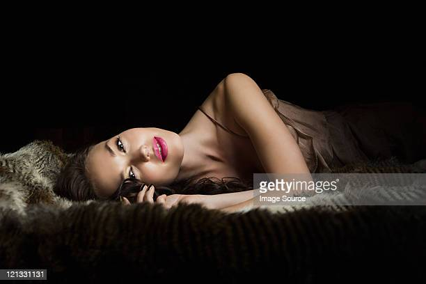young woman lying on blanket, portrait - women in slips stock pictures, royalty-free photos & images