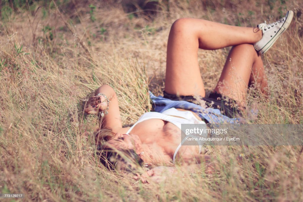Young Woman Lying On Grass In Field : Photo