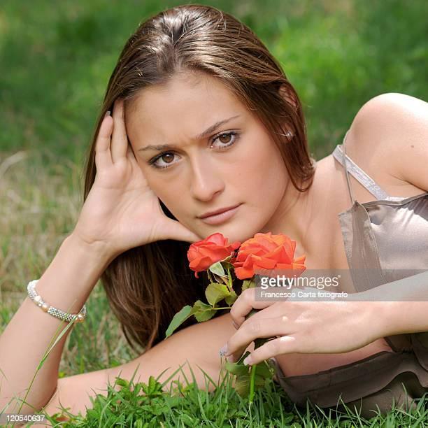 young woman lying on grass - tempio pausania stock-fotos und bilder