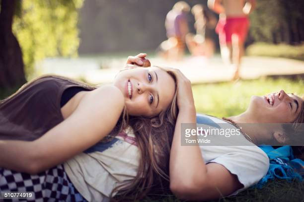 young woman lying on her boyfriend's stomach - innocenza foto e immagini stock