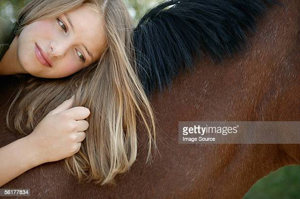 young woman lying on her horse - black hairy women stock pictures, royalty-free photos & images