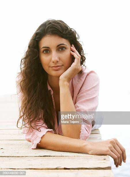 young woman lying on jetty, portrait - mediterranean sea stock pictures, royalty-free photos & images