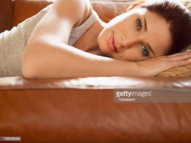 Young woman lying on sofa