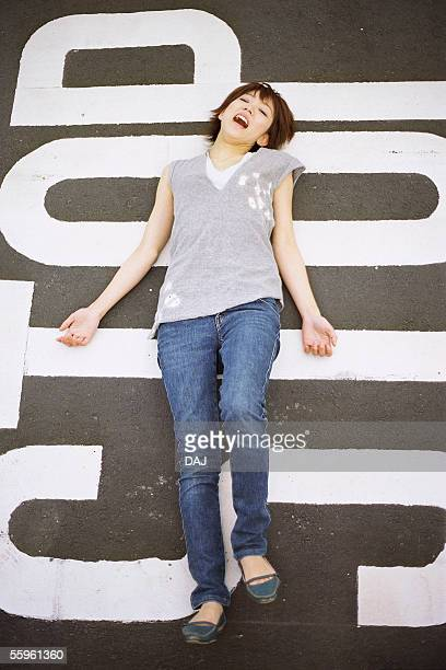 Young woman lying on the street, portrait