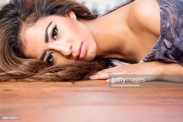 Young woman lying on wooden floor