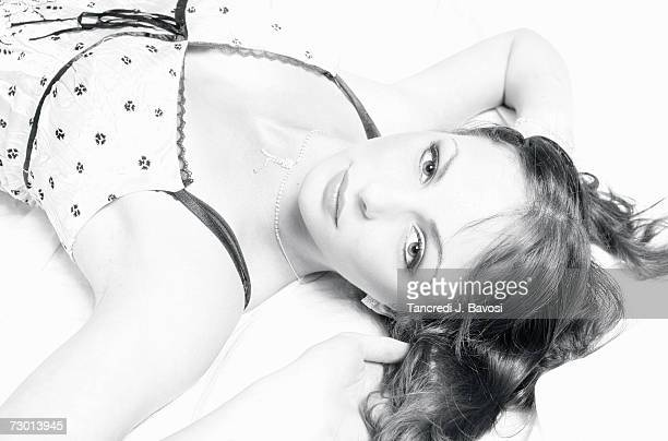 young woman lying with hands behind head, portrait - bavosi stock pictures, royalty-free photos & images