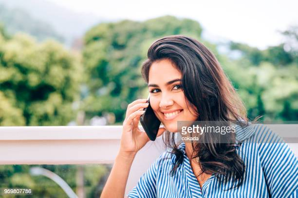 Young woman making a call on cell phone