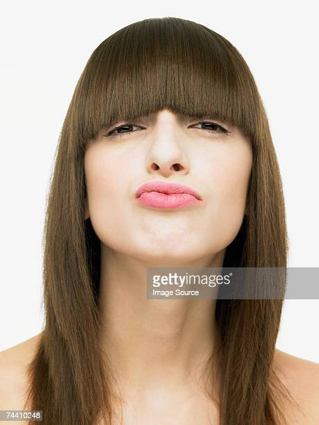 young woman making a face - straight hair stock pictures, royalty-free photos & images