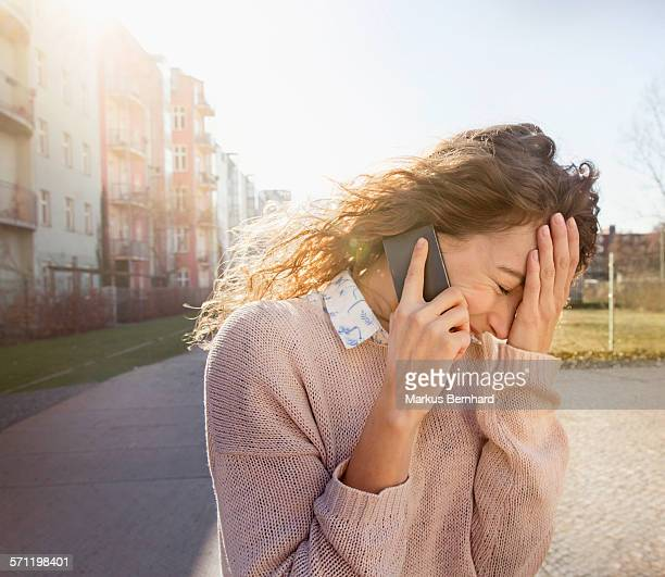 Young woman making a phonecall.