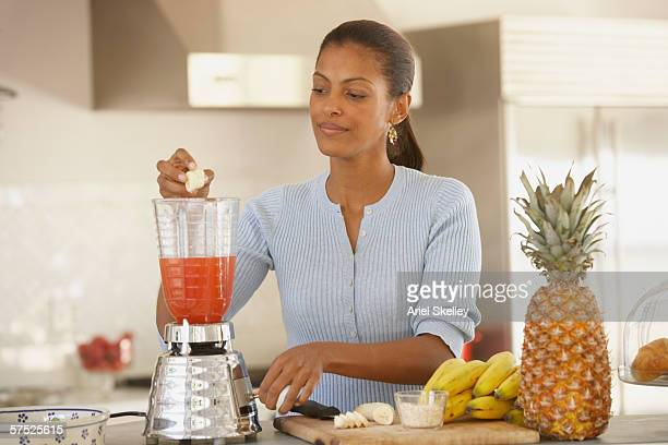 Young woman making a smoothie
