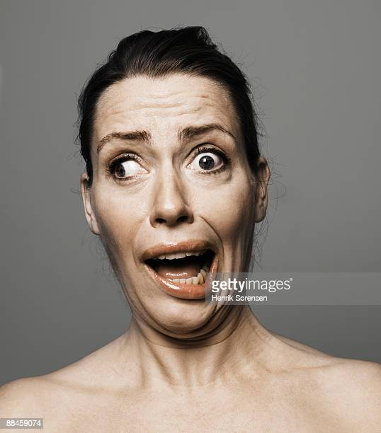 young woman making crazy faces - grimassen stockfoto's en -beelden