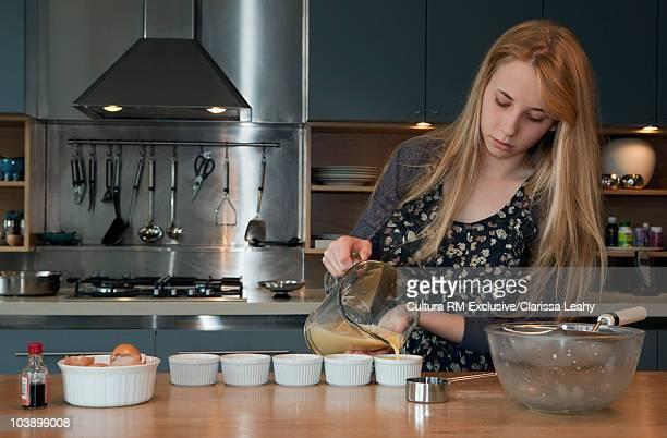 Young woman making creme caramel