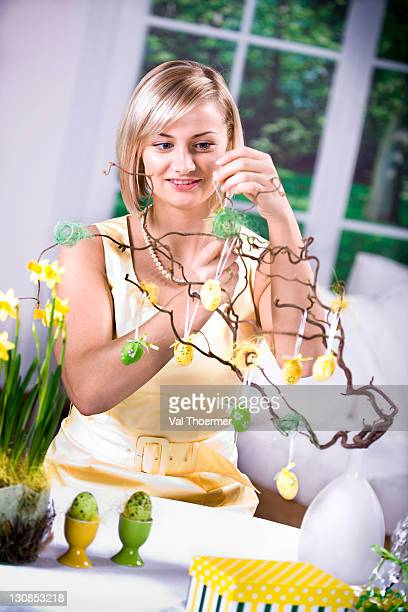 young woman making easter decorations - happy resurrection day stock pictures, royalty-free photos & images