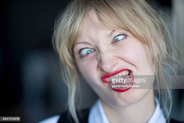 Young woman making funny faces.