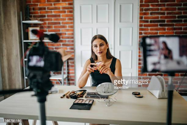 young woman making make-up tutorial - live streaming stock pictures, royalty-free photos & images