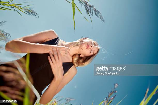Young woman making stretch exercises in desert
