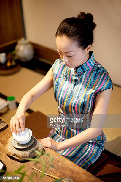 young woman making tea - ceremony stock pictures, royalty-free photos & images