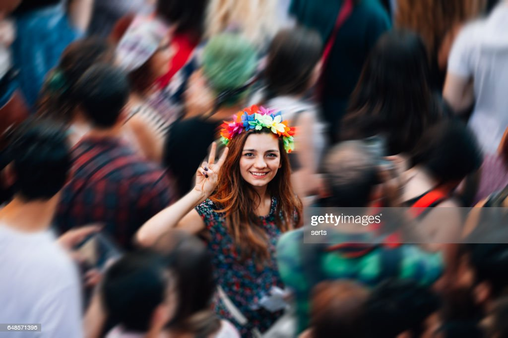 Young woman making victory sign with hand enjoying the protest : Stock Photo