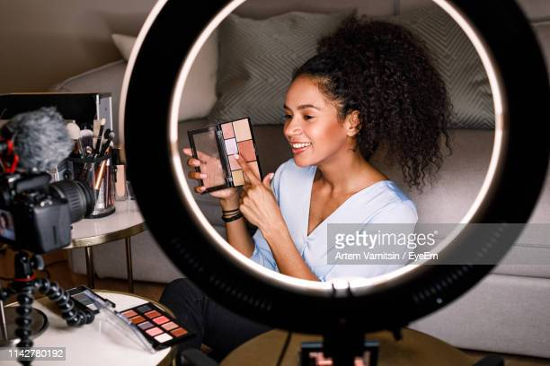 young woman making video on make-up blog at home - influencer stock pictures, royalty-free photos & images