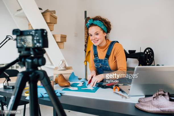 young woman making vlog about making shoes - film set stock pictures, royalty-free photos & images