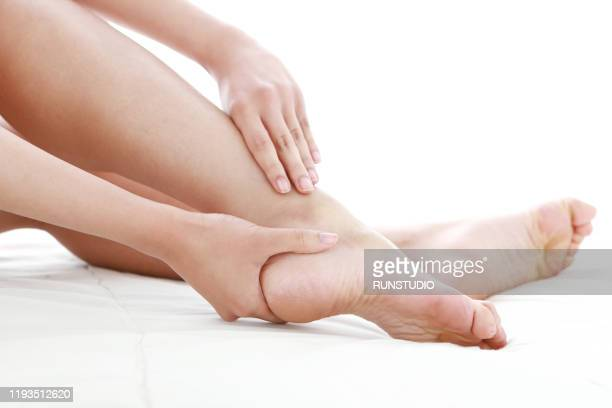 young woman massaging foot - body massage japan stock pictures, royalty-free photos & images