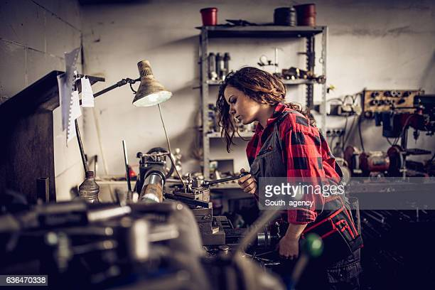 young woman mechanic - craftsman stock photos and pictures